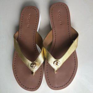 COACH gold leather flip flops , 36